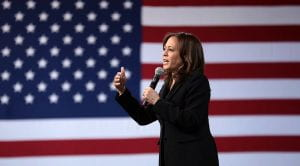 Image of Kamala Harris speaking in front of an American flag