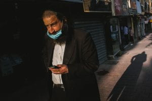 A man walks down the street during the Bnei-Brak Coronavirus shutdown in Israel