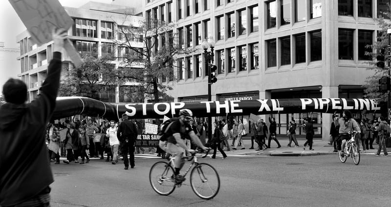 """A fake pipeline with the words """"stop the xl pipeline"""" protesting the pipeline"""