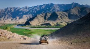 Photo of armored car driving through mountains of Afghanistan