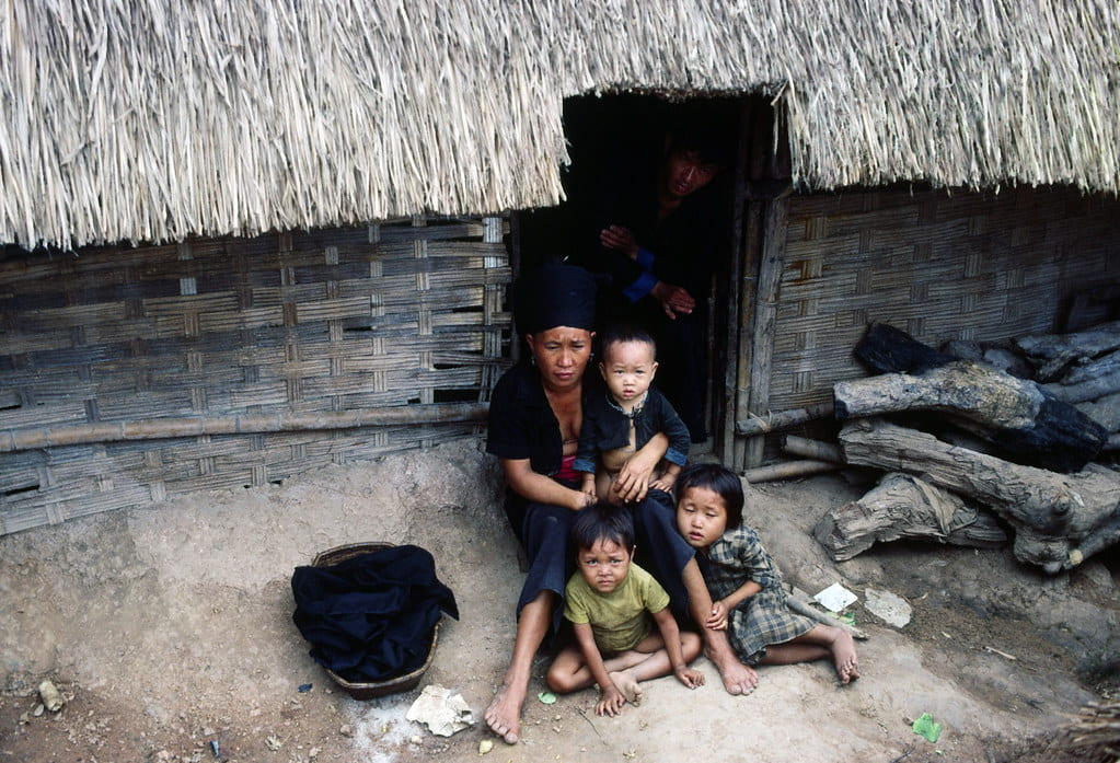 Refugees outside of a small hut
