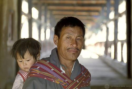 Bhutanese man with child