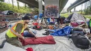 An image portraying an encampment under a bridge