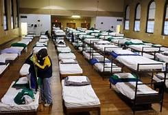 An image of a crowded homeless shelter
