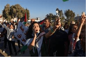 Palestinians Gathering to Protest the Rearrest of the six Palestinian Prisoners.