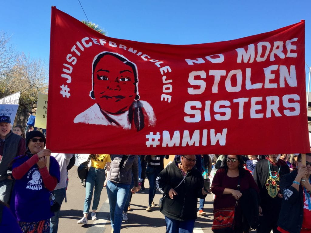 """Banner with the words """"No more Stolen Sisters"""" at a protest for missing indigenous women"""