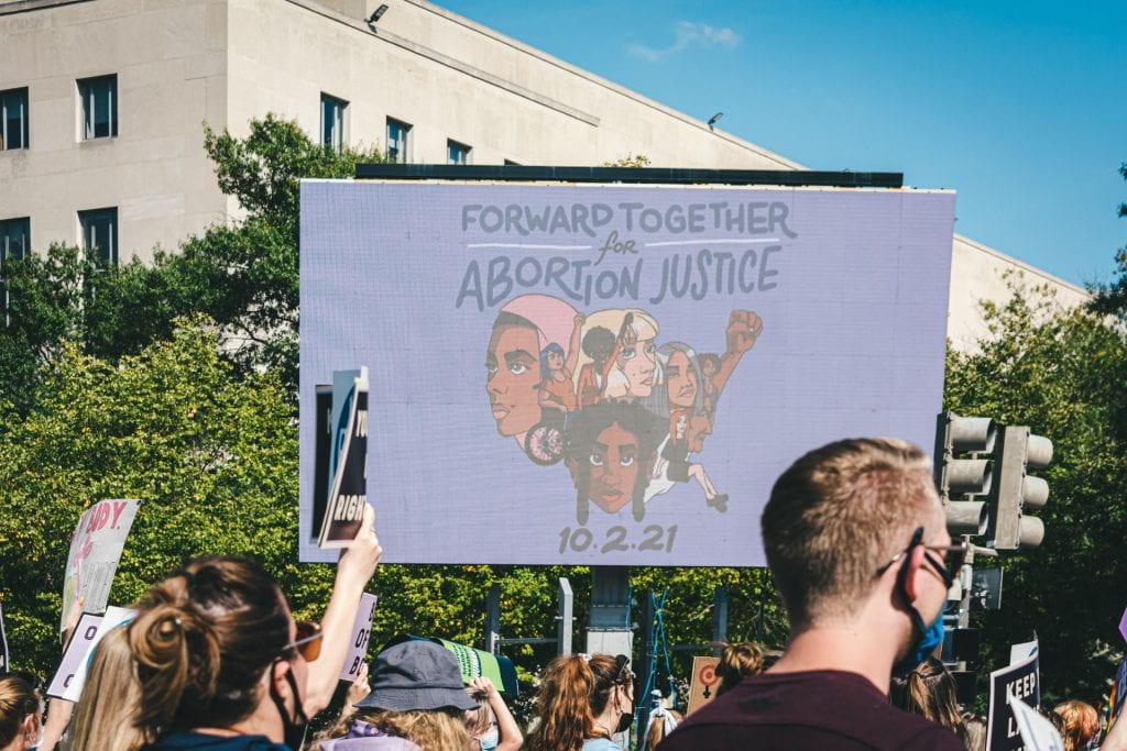 "Billboard titled ""Forward Together for Abortion Justice"""