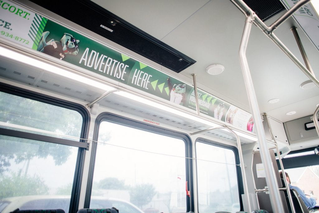 bus ad card above window