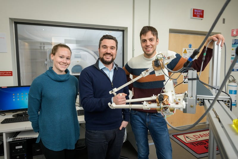 Prof. Fabrizio Sergi (center) is joined by Andria Farrens (left) and Andrea Zonnino, both of whom are doctoral students in biomedical engineering.