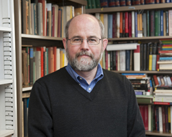 Professor of History James Brophy photographed in his Munroe Hall office for a UDaily article.