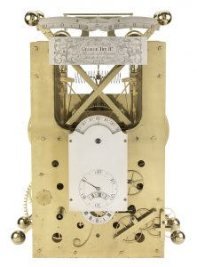 Three scientific instruments invented by John Harrison are pictured here. They are a combination of metal plates, dials, springs, and weights with clock dials on the front.