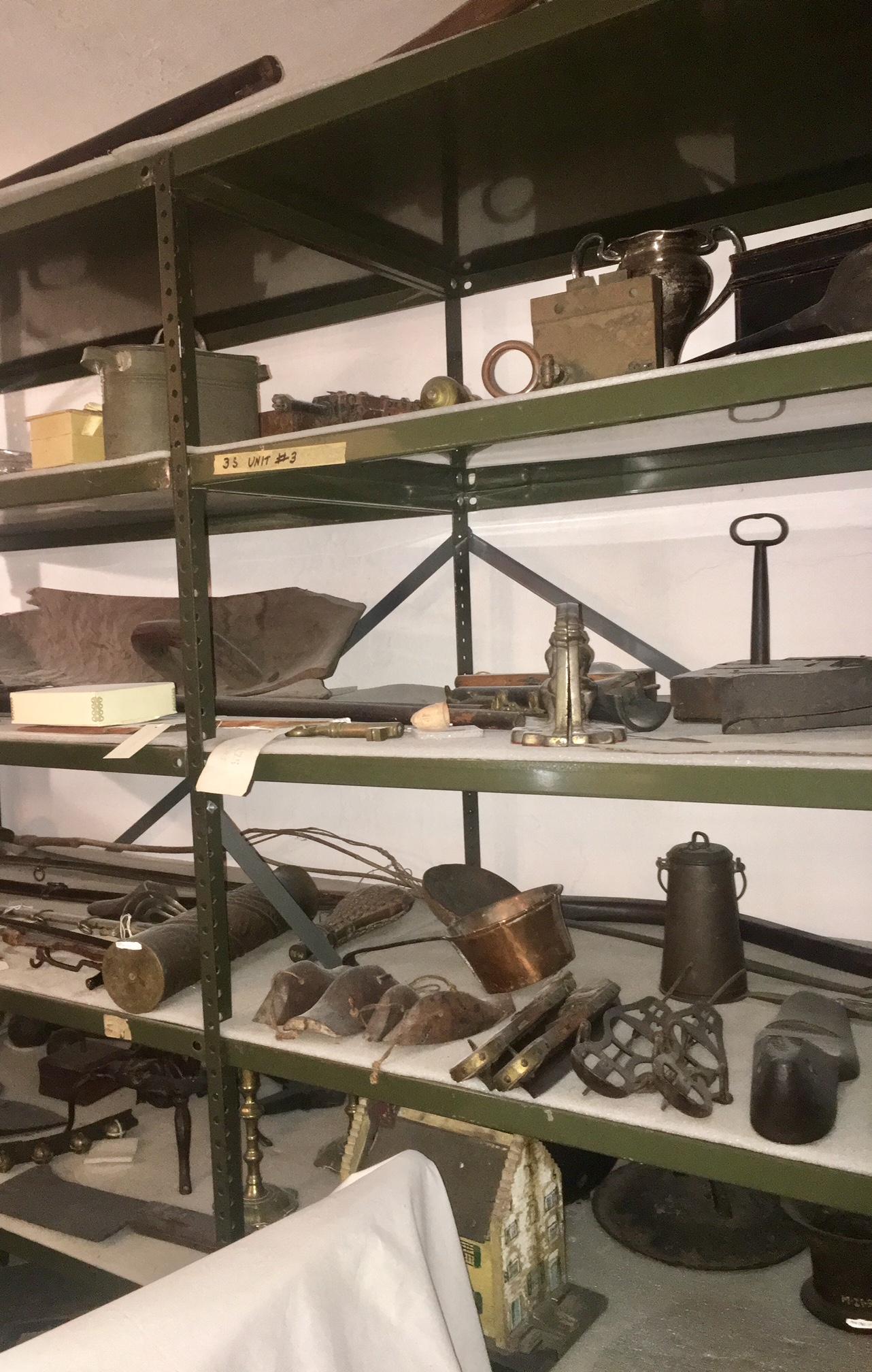 Various tools line a set of metal shelves