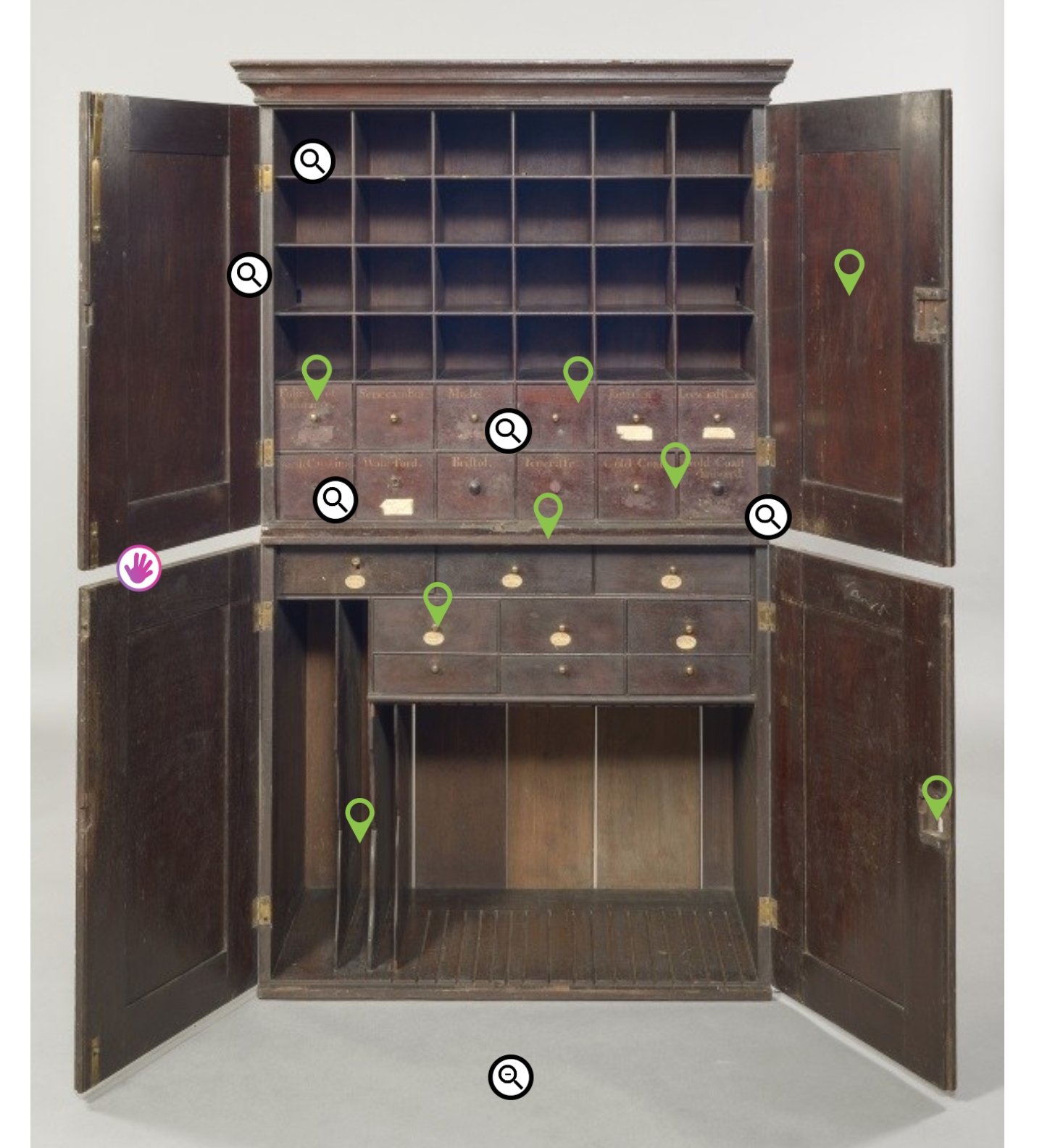 The home screen for the digital interactive features a still image of the mahogany double cabinet, with the doors open, and various points marked with symbols for guests to touch and learn more.
