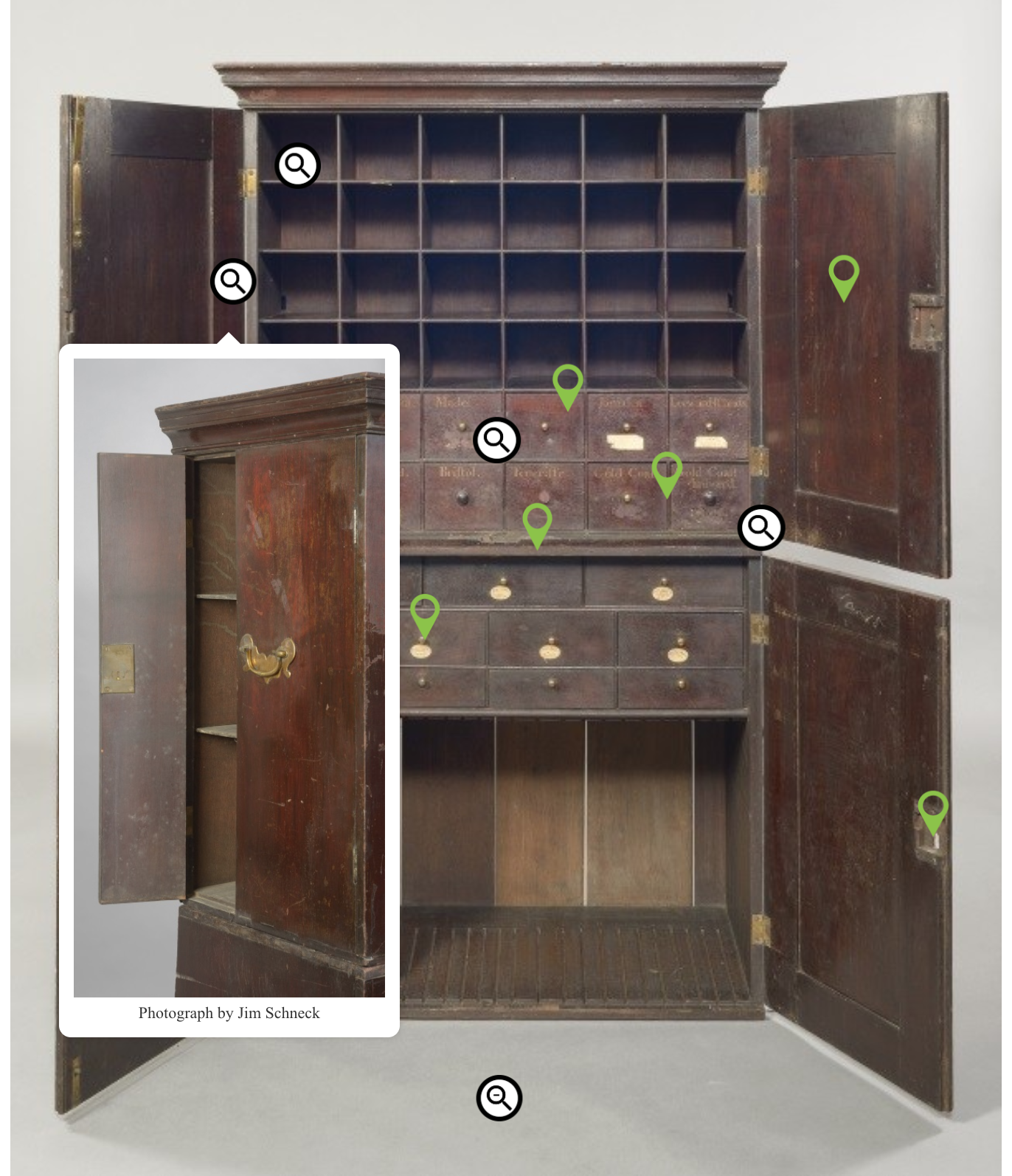 An example of the type of pop-up created by the touch screen interactive of a picture of a side compartment on the cabinet, obscured when the cabinet's doors are fully open.