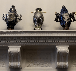 contemporary ceramics on a mantel in the Double Parlor at 1 West.