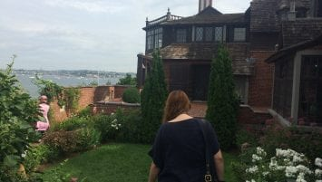 WPAMC Class of 2019 fellows walk through the whimsical garden of Beauport, the Sleeper-McCann House to a ledge that overlooks the blue waters of Gloucester Harbor.
