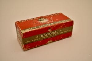 "image of small red rectangular box with black and white labeling that reads ""National Goggles – Industrial Gases and Welding Supplies; National Cylinder Gas Company, 205 W. Wacker Drive, Chicago, Ill."""
