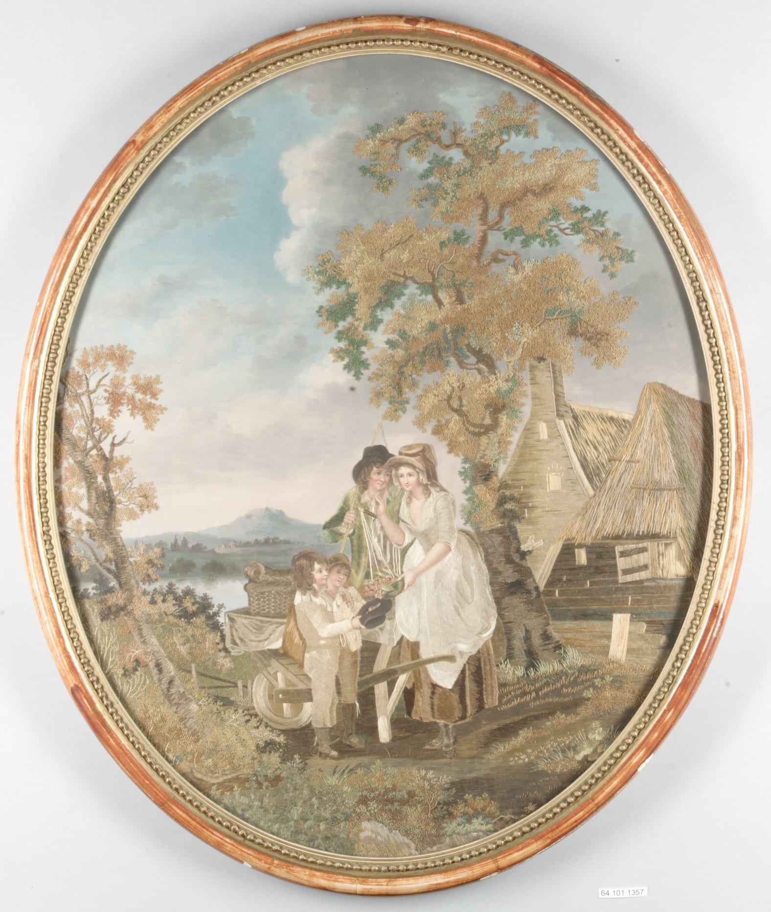 This oval embroidery shows a woman with a scale overflowing with cherries, two young boys holding out a hat filled with cherries, and a man with a whip standing behind the woman's shoulder and gazing amorously at her face. They are in a pastoral landscape with a mountain and lake in the far background and a house and barn with thatched roofs in the nearer background.