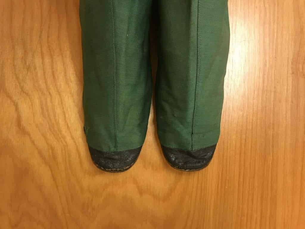 A close photo of the toes of the green pair of ladies' half boots: the toes are slightly square and tipped in black leather.