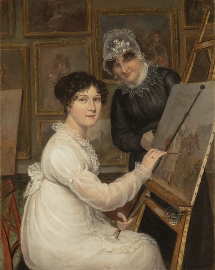A woman in white sits at an easel and paints a woman standing in front of a horse. A woman in black watches the woman in white paint. The wall behind them is covered with paintings in gold frames.