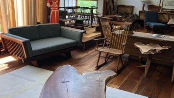 A wide angle shot of the Nakashima living room turned gallery.