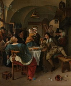 A painting of a rowdy group of people gathered around a table in a crowded room.  The man on the right smokes from a long ceramic pipe.