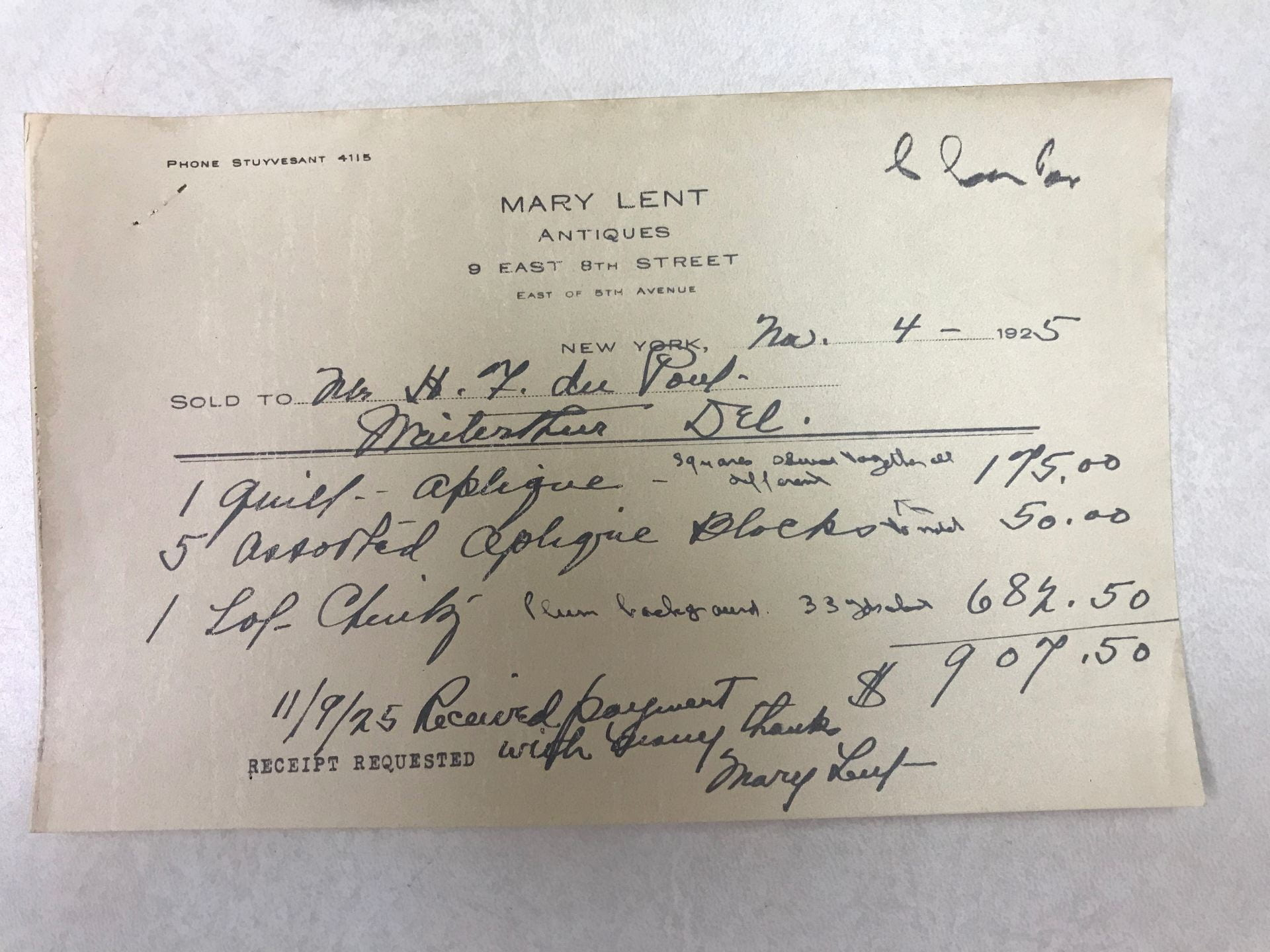 """A piece of paper with handwriting for a bill of sale from Mary Lent to H.F. du Pont that reads """"1 quilt – aplique, all squares sewn together all different"""" and """"5 assorted aplique blocks to match"""" for $225.00."""