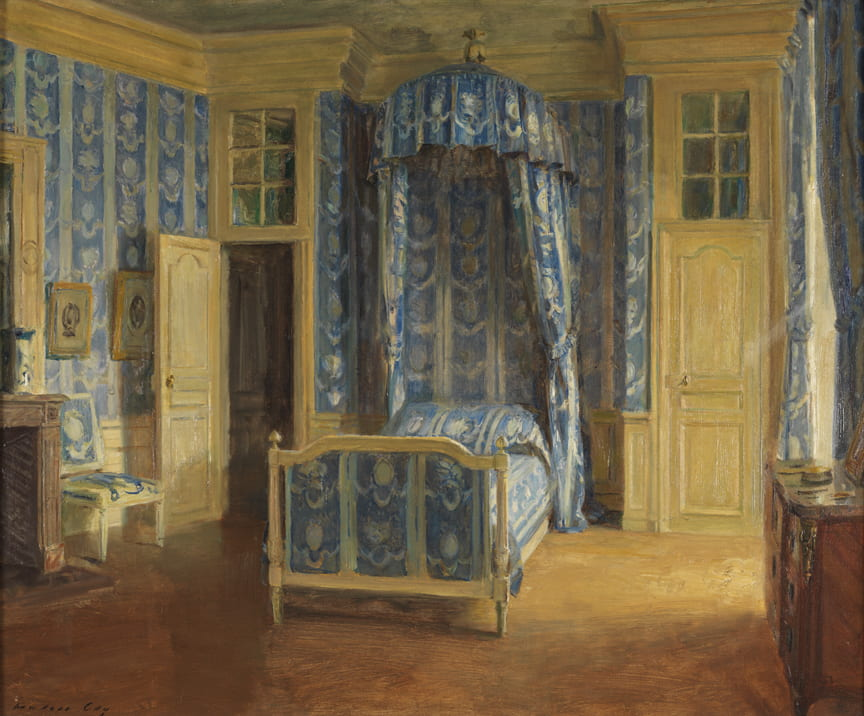 Bedroom with chair, bed with blue coverings and a canopy, and open draperies.