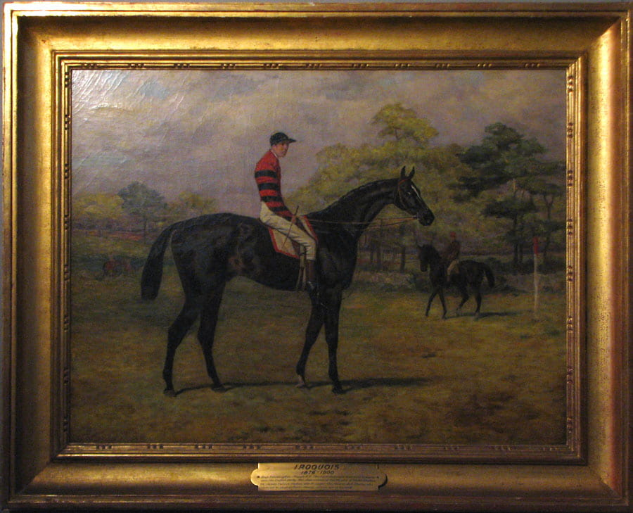 Figure 4. Painting of black horse facing right with jockey on its back and other horse and jockey in the background.