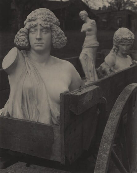 Fig. 5. Photograph of wooden cart with three antique sculptures.