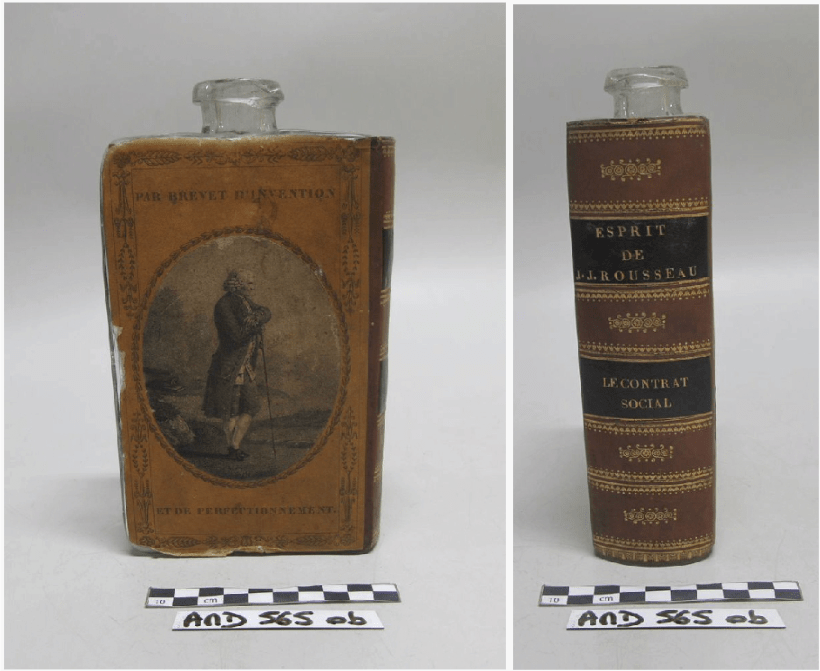 "Back of glass flask covered with brown paper to imitate the back cover of a back with a print of Rousseau in the center; Brown and Black imitation leather made to look like the spine of a book with gold gilt decoration and the text, ""Esprit de Rousseau"" and ""Le Contrat Social."""