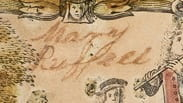 """Black ink handwriting on paper containing the name, """"Mary Russell""""."""