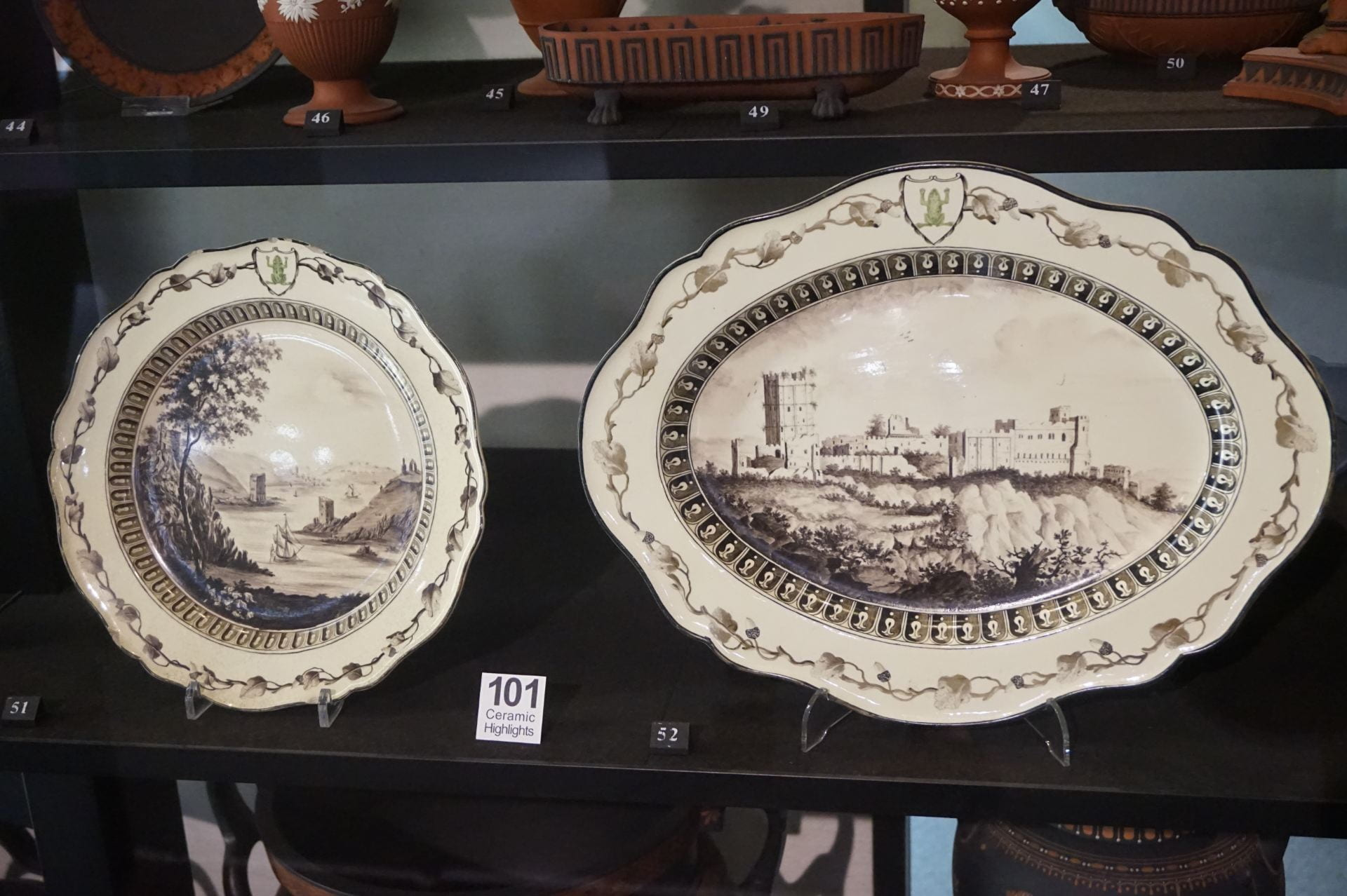 two black and white transferware plates