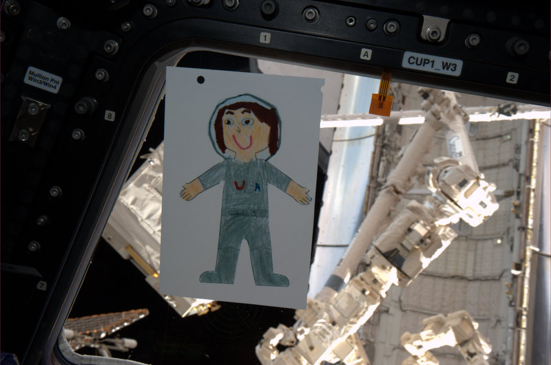 Flat Samantha in the ISS Cupola (photo by Gregory Johnson)