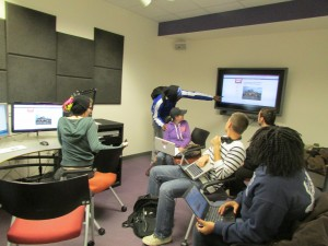 Students using the multimedia design center to work on a group project for SOCI 471 Disaster, Vulnerability, and Development in Fall semester, 2013