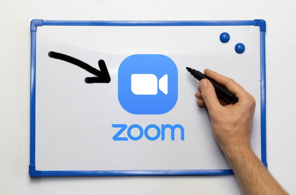 Whiteboard with a Zoom logo and a hand holding a marker
