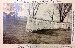 Tree planting ceremony in 1917 by the students of the Women's College.  Courtesy of the University Archives
