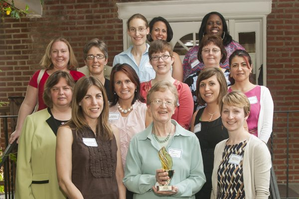 The Women's Caucus presents the 2012 Torch Bearer Award to Anne Boylan.