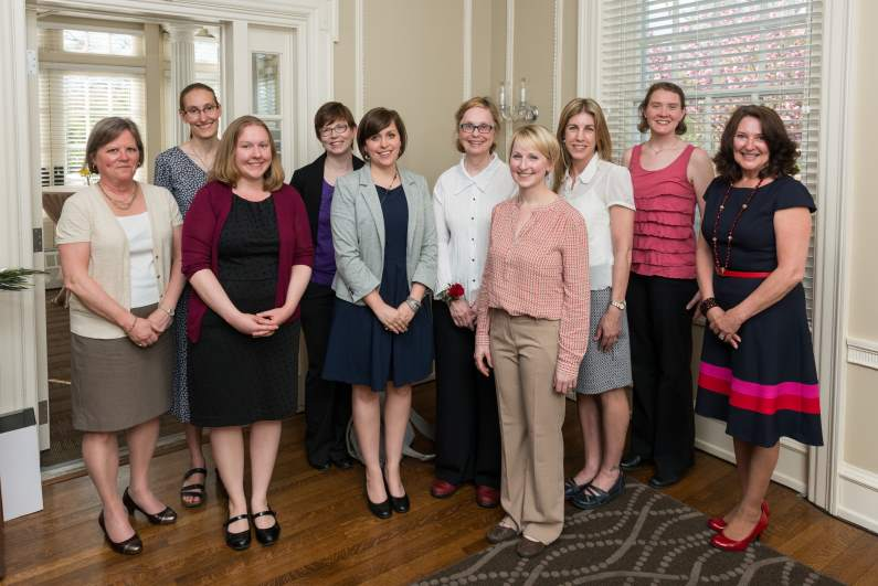 The 2014 Women's Caucus Board poses with Torch Award winner Pam Cook.