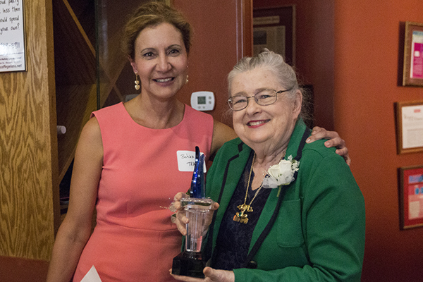 2015 Torch Award winner Barbara Settles (right) poses with Professor Bahira Trask