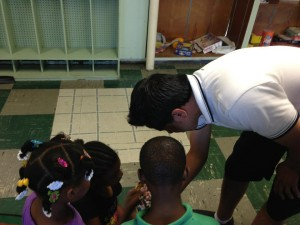 Lu'ay greeting the children at Kingswood Center