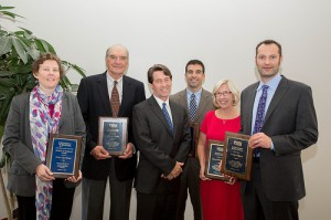 2015 Worrilow Award Winner Erica Spackman (left) displays her plaque alongside CANR Distinguished Alumni Award winners. Joining them is CANR Dean Mark Rieger (third from left). For the full story on the 2015 award and additional photos, click