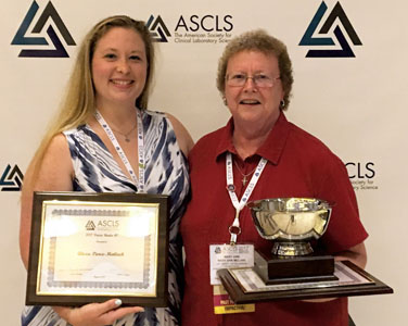 Faculty Member and Alumna Win Awards