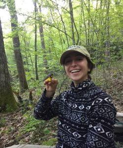 Amanda holding a canada warbler!