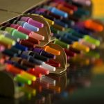 Boxes of multicolored crayons.