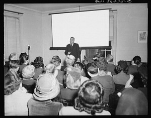 The presentation technology has changed, but Alison's audience was likely as engaged as was the audience pictured here in 1944 at the United Nations Club in Washington, D.C. (Courtesy Library of Congress)