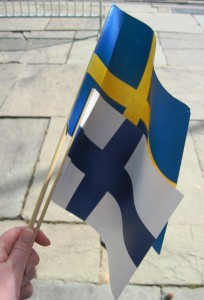 Each attendee received two flags. Although the commemorators wanted to celebrate the Swedish and the Finnish colonists equally, Sweden's flag was larger. Some of the commemorators of the 300th anniversary in 1938 did not want the Finns involved at all.