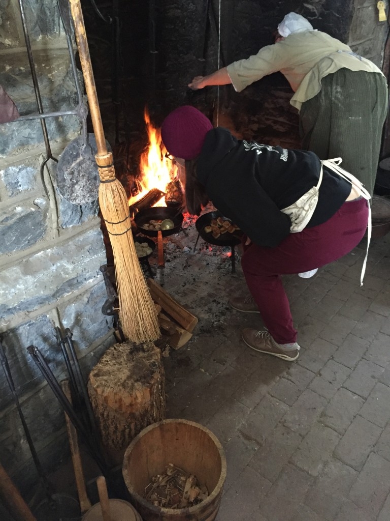 Nicole flipping meatballs over an open hearth (a 1930s-era reconstruction) at Landis Valley, February 2015