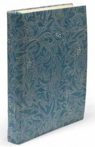 William Morris's The Works of Geoffrey Chaucer Now Newly Printed, commonly called the Kelmscott Chaucer and printed at Morris's Kelmscott Press in 1896. The book is seen here in a slipcover made in the early twentieth century from William Morris fabric.