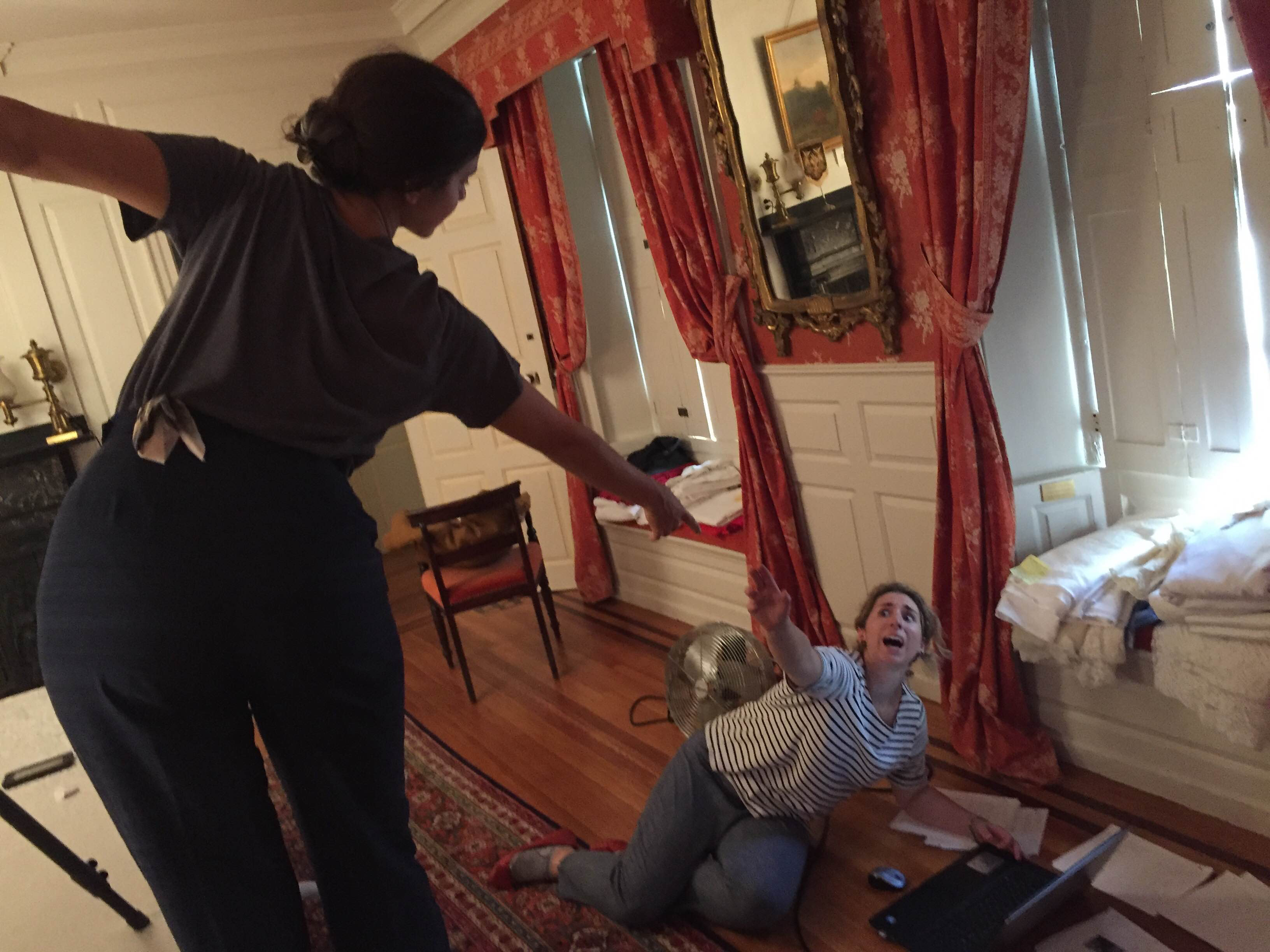 From atop the stepstool, Zoe passes the camera's memory card to a recumbent Claire